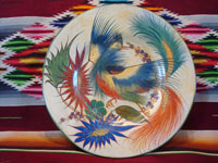Mexican vintage pottery and ceramics, a very beautiful burnished charger featuring a fanciful and graceful bird with outstretched wings, Tonala or Tlaquepaque, Jalisco, 1920-30's. Main photo of Tonala burnished charger.