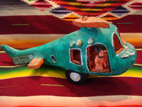 Mexican vintage folk-art, and Mexican vintage pottery and ceramics, a beautiful and fanciful pottery helicopter filled with a very happy pilot and passengers, signed Candelario Medrano, the very famous folk-artist from Santa Cruz de Las Huertas, Jalisco, c. 1950's. Main photo of the Medrano helicopter.