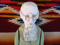 Mexican vintage folk art, and Mexican vintage woodcarving, a carved wooden figure depicting the famous Mexican artist, Dr. Atl (Gerado Murillo), by the also famous Mexican folk artist, Manuel Jimenez, Arazola, Oaxaca, c. 1950-60's. Closeup photo of the wooden figures face and glasses.