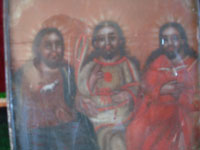 Mexican vintage devotional art, and Mexican vintage tinwork art, a framed retable painted on tin and depicting the Holy Trinity, Mexico, c. 1900-20, or earlier.  Closeup photo of the Trinity painted on the tin retablo.