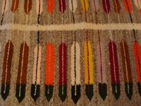 Native American Indian textiles, and Navajo rugs and textiles, a wonderful Navajo pictorial rug, decorated with 44 lovely feathers and beautifully woven of hand-spun wool, Arizona or New Mexico, c. 1940's. Closeup photo of the Navajo pictorial rug.