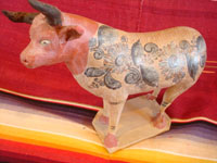 Mexican vintage pottery and ceramics, and vintage Mexican folk art, a wonderful burnished pottery bank in the form of a wonderful bull, with very detailed artwork on both sides, Tonala or Tlaquepaque, c. 1930's. Main photo of the burnished pottery bull from Tonala or Tlaquepaque.