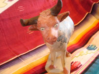 Mexican vintage pottery and ceramics, and vintage Mexican folk art, a wonderful burnished pottery bank in the form of a wonderful bull, with very detailed artwork on both sides, Tonala or Tlaquepaque, c. 1930's. A photo showing the face of the burnished pottery bull from Tonala or Tlaquepaque.