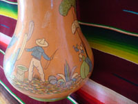 Mexican vintage pottery and ceramics, a beautiful pottery vase with very fine artwork decoration, Tlaquepaque or Tonala, Jalisco, c. 1930's. Another closeup photo of the Mexican man on the Arias pottery vase from Tlaquepaque.