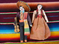 Mexican vintage folk art, a pair of handmade cloth dolls with incredibly fine detail, c. 1930's. Main photo of the Mexican dolls.