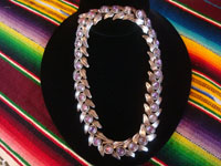 Mexican vintage sterling silver jewelry, and Taxco vintage sterling silver jewelry, an exquisite silver necklace with 32 cabochons of wonderful amethyst, Taxco, c. 1940's. Main photo of the Taxco silver jewelry necklace.