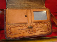 Mexican vintage folk art, and Mexican vintage leather-work, a beautiful leather purse with wonderful tooled floral designs, c. 1930's.  Photo showing the inside of the purse with the mirror and compartments.