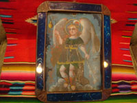Mexican vintage devotional art, and Mexican vintage tinwork- art, a beautiful retablo depicting the Archangel Rafael, in a stunning tinwork-art frame with reverse painting on the glass border, c. 1880-1900.  Main photo of the front of the retablo.