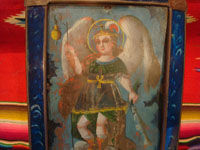 Mexican vintage devotional art, and Mexican vintage tinwork- art, a beautiful retablo depicting the Archangel Rafael, in a stunning tinwork-art frame with reverse painting on the glass border, c. 1880-1900.  A closeup photo showing the upper part of the retablo.