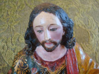 Mexican antique Colonial art, and Mexican Colonial devotional art, an incredible hand-carved Nativity set with wonderful statues of Jesus, Mary, and Joseph, Mexico, c. 17th-18th century. Closeup photo of the face of St. Joseph.