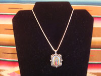 Mexican vintage devotional art, and Mexican vintage silver jewelry, a beautiful pendant/pin on a silver chain, with a lovely image of Our Lady of Guadalupe, painted on porceline, c. 1940. Photo showing the entire necklace, with the silver chain.