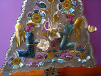 Mexican vintage folk art, and Mexican vintage tinwork art, a lovely tinwork-art Christmas tree beautifully decorated with angels and birds, Oaxaca, c. 1950's. A closeup photo of part of the front of the tinwork-art tree.