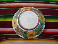 Mexican vintage pottery and ceramics, a lovely talavera bowl decorated with the image of the Baby Christ, along with his Mother, Mary, and St. Anne, the mother of Mary, Guanajuato, c. 1950's.  A photo showing the bottom of the bowl.