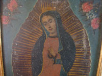 Mexican vintage devotional art, and Mexican vintage tinwork art, a beautiful retable depicting Our Lady of Guadalupe, painted on tin and framed, c. 1930. Closeup photo of Our Lady's face.