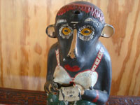 Mexican vintage folk art, and Mexican vintage pottery and ceramics, a wonderful monkey bottle for mezcal, Oaxaca, c. 1930's.  Closeup photo of the monkey's face.