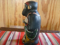Mexican vintage folk art, and Mexican vintage pottery and ceramics, a wonderful monkey bottle for mezcal, Oaxaca, c. 1930's.  A side view of the bottle.