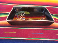 Mexican vintage pottery and ceramics, a rectangular dish, blackware, with a wonderful scene of a snoozing Mexican peasant under a tree, Tlaquepaque, c. 1930-40's. A photo showing a side view of the dish.