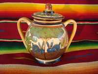 Mexican vintage pottery and ceramics, a lidded jar with handles from Tlaquepaque, Jalisco, c. 1930's. The lidded jar has the petatillo hatch-work pattern in the background, and features two wonderful blue bunnies amidst foliage on both the front and the back. Main photo.