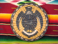 Native American Indian antique basket, a Hopi wicker plaque with eagle design, c. 1930. A photo showing the unfaded back side of the plaque.