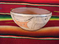 Native American Indian antique pottery, a chili bowl from Santa Ana Pueblo in New Mexico, c. 1910-20. The painted decorations on the bowl have faded with time, but are still incredibly beautiful. Main photo.