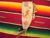 Native American Indian beadwork and folk art, a Plains knife-sheath with ghost-dance designs and symbolism, c. 1890-1910. The sheath is sinew sown with brain-tanned leather, and with fringe and bottom-tassles with beads. Main photo.