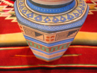 Mexican vintage pottery and ceramics, a vase with geometric prehispanic designs by the famous artist, Ladislao Ortega, Tonala, Jalisco, c. 1930's. Closeup photo of one side of vase.