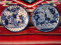 Mexican vintage pottery and ceramics, two very beautiful plates with a white background and wonderful blue artwork decoration, Tlaquepaque, c. 1930-40's. Main photo showing the two plates.