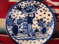 Mexican vintage pottery and ceramics, two very beautiful plates with a white background and wonderful blue artwork decoration, Tlaquepaque, c. 1930-40's. Closeup photo of one of the plates, showing the pineapple vendor.
