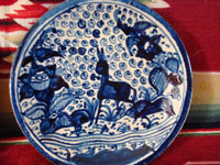 Mexican vintage pottery and ceramics, two very beautiful plates with a white background and wonderful blue artwork decoration, Tlaquepaque, c. 1930-40's. Photo of the second plate, showing the wonderful burro and floral design of the plate.
