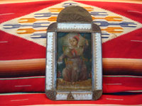 Mexican vintage tinwork-art (tin art), and Mexican vintage devotional art and retablos, a very fine painting on tin of the Santo Nino de Atocha, mounted in an early and very fine tinwork-art nicho, c. 1910-20's. Main photo of the tin nicho and retablo.