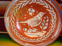 Mexican vintage pottery and ceramics, a pair of bandera-ware plates with graceful birds, Tonala or Tlaquepaque, Jalisco, c. 1930's. Closeup photo of one plate.