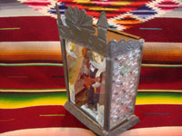 Mexican vintage tinwork art, and Mexican vintage devotional art, a beautiful tin and glass nicho with a statue of St. Fabian playing his guitar and with two lovely angels, Oaxaca, c. 1940's. Side view of the nicho.