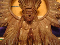Mexican vintage devotional art, and Mexican vintage wood-carvings and masks, a lovely and finely carved wooden statue of Our Lady of Good Health (N.S. de la Salud), patroness of Michoacan, Patzcuaro, c. 1930's. A closeup photo of Our Lady's face.