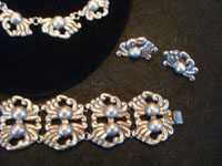 Mexican vintage sterling silver jewelry, and Taxco vintage sterling silver jewelry, a beautiful sterling silver set (necklace, bracelet, and earrings), from Taxco, a silver and jewelry center of Mexico, c. 1940's. Closeup photo of the bracelet and earrings.