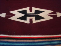 Mexican vintage serapes and textiles, and New Mexican vintage textiles, a very lovely woolen, pictorial runner with a beautiful burgundy background, Chimayo, New Mexico, c. 1940's. Photo showing the design at one end of the Chimayo textile.