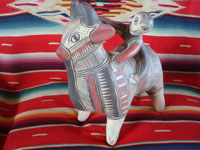 Mexican vintage folk art, and Mexican vintage pottery and ceramics, a wonderful pottery figure of a powerful bull with one happy rider, Guerrero, c. 1940's. Main photo of the bull and rider from Guerrero.