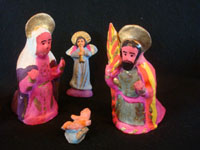 Mexican vintage folk art, and Mexican vintage devotional art, a beautiful and brightly decorated pottery nativity set, Metepec, c. 1940's. Photo showing the Holy Family, part of the nativity set from Metepec.