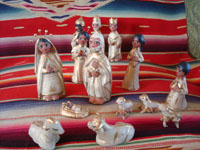 Mexican vintage folk art, and Mexican vintage devotional art, a pottery nativity set with white and gold decoration, Tlaquepaque, Jalisco, c. 1950's. Main photo of the nativity set from Tlaquepaque.