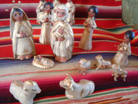 Mexican vintage folk art, and Mexican vintage devotional art, a pottery nativity set with white and gold decoration, Tlaquepaque, Jalisco, c. 1950's. Another view of the set.