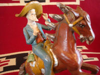 Mexican vintage folk art, and Mexican vintage pottery and ceramics, a wonderful pottery sculpture of a Mexican vaquero (jinete, or Mexican cowboy) on his gallant horse, attributed to the famous Panduro family, Guadalajara or Tonala, Jalisco, c. 1930's.  Closeup photo of the cowboy and horse.