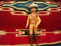 Mexican vintage folk art, and Mexican vintage woodcarvings and masks, a woodcarving depicting the hero of the Mexican revolution, Emiliano Zapata, by the famous folk artist Manuel Jimenez of Arrazola, Oaxaca, c. 1950's. Main photo of the carving.