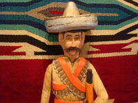 Mexican vintage folk art, and Mexican vintage woodcarvings and masks, a woodcarving depicting the hero of the Mexican revolution, Emiliano Zapata, by the famous folk artist Manuel Jimenez of Arrazola, Oaxaca, c. 1950's. Closeup photo showing the top part of the carving.