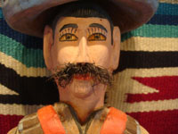 Mexican vintage folk art, and Mexican vintage woodcarvings and masks, a woodcarving depicting the hero of the Mexican revolution, Emiliano Zapata, by the famous folk artist Manuel Jimenez of Arrazola, Oaxaca, c. 1950's. Closeup photo of Zapata's face with his famous mustache.