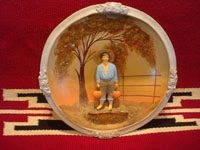 Mexican vintage pottery and ceramics, and Mexican vintage folk art, a shell-like mounted scene of a Mexican campesino with his water jars, attributed to Maura Panduro, daughter of Pantaleon Panduro, c. 1930. Main photo of the plate.