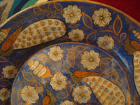 Mexican vintage pottery and ceramics, a beautiful charger, decorated with lovely peacocks and flowers, San Pedro Tlaquepaque or Tonala, Jalisco, c. 1930's. Closeup photo of one edge of the charger, showing additional peacocks.