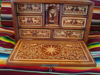 Mexican vintage folk art, and Mexican vintage woodcarvings and masks, a fabulous wooden escritorio (portable writing desk) with very fine marquetry inlay work, Oaxaca, c. 19th century. Photo with the front cover opened and showing the marquetry of the inside of the desk.