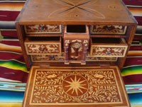 Mexican vintage folk art, and Mexican vintage woodcarvings and masks, a fabulous wooden escritorio (portable writing desk) with very fine marquetry inlay work, Oaxaca, c. 19th century. Another photo of the inside of the desk, with the cover open and showing some open drawers.
