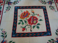 Mexican vintage sarapes and textiles, a lovely weaving from Oaxaca, c. 1910-20. The textile features lovely roses; it is an incredible piece of art. Closeup photo of the center of the textile.