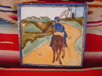 Mexican vintage pottery and ceramics, a talavera tile from Puebla, c. 1940's. The tile is hand-painted with a scene of Don Quixote, the Man of La Mancha, mounted on his horse and holding his lance. Main photo.