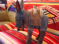 Mexican vintage folk-art and Mexican vintage wood-carving, a wonderful pair of wood-carved and hand-painted burros, complete with painted saddles and horse-hair (or burro-hair) tails, c. 1930.  Another view of the side of one of the wood-carved burros.